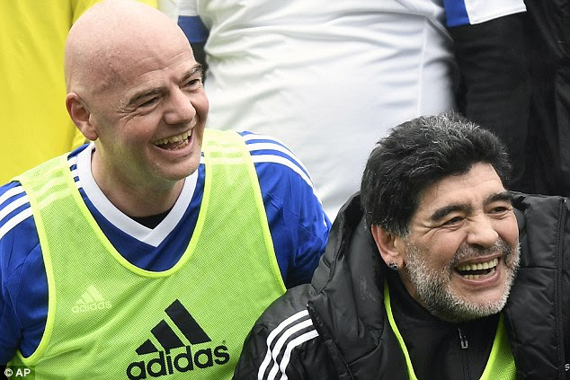 Diego Maradona, pictured with Infantino, has backed plans for World Cup expansion