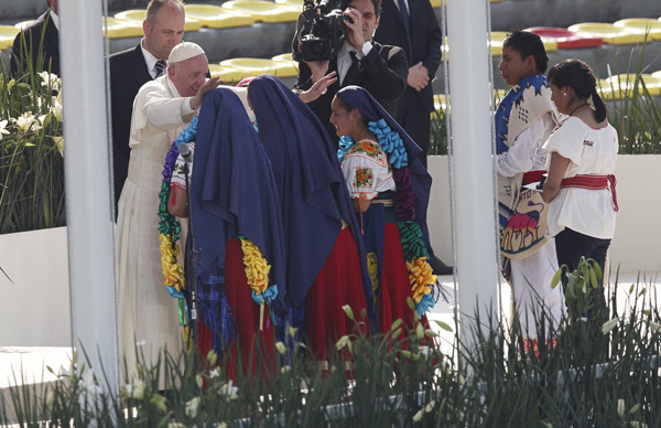 The Holy Father greets girls in traditional dress during a meeting with young people at the Jose Maria Morelos Pavon Stadium in Morelia, Feb. 16. Photos © Catholic News Service/Paul Haring