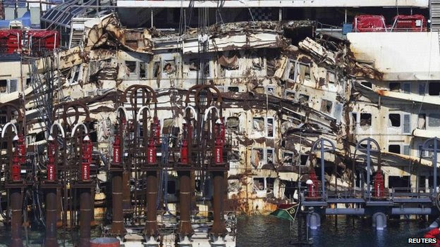 A damaged part of the cruise liner Costa Concordia is seen at Giglio harbour, Giglio Island, 13 July 2014