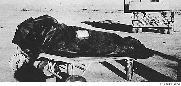 """FILE--This photo is from the Air Force's """"The Roswell Report,"""" released Tuesday, June 24, 1997, which discusses the UFO incident in Roswell, N.M. in 1947. On balloon flights, test dummies were used and placed in insulation bags to protect temperature sensitive equipment. These bags may have been described by at least one witness as """"body bags"""" used to recover alien victims from the crash of a flying saucer. The 231-page report, released on the eve of the 50th anniversary of the Roswell, N.M., UFO incident, is meant to close to book on longstanding rumors that the Air Force recovered a flying saucer and extraterrestrial bodies near Roswell. (AP Photo/Air Force, File) BLACK AND WHITE ONLY / DATE AND PLACE OF PHOTO UNKNOWN Ran on: 08-16-2004"""