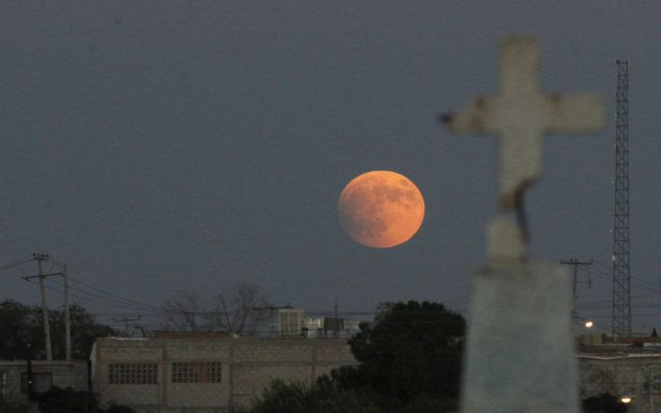 A supermoon, the last of this year's supermoons, is pictured in the sky in Ciudad Juarez