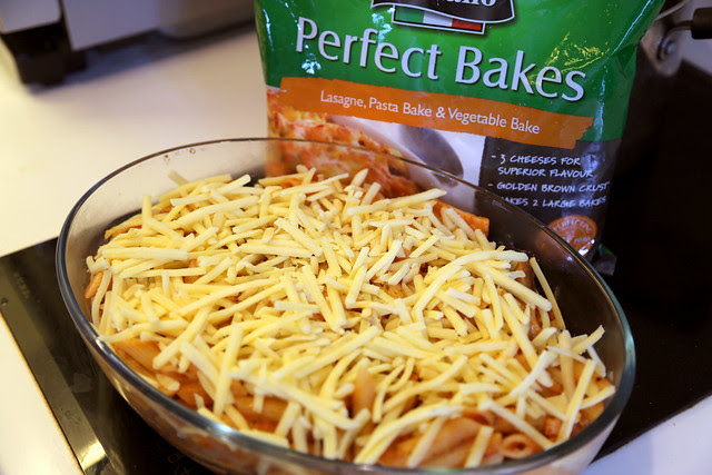 Liberally top the pasta with the Perfect Italiano Perfect Bakes cheese