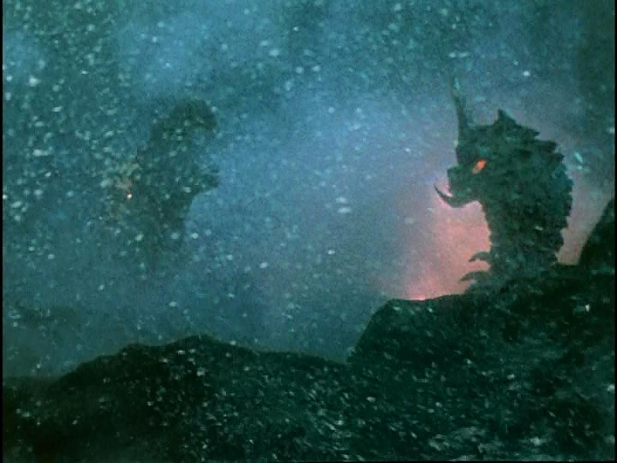 Battra and Godzilla fight so hard they open a magma fissure