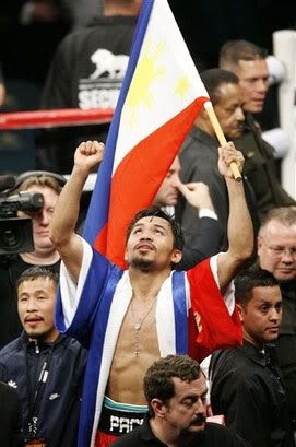 Manny Pacquiao celebrates after beating Oscar De La Hoya by TKO after the 8th round on December 6, 2008, at the MGM Grand Hotel in Las Vegas.