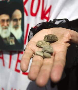 Tit for tat. An Iranian woman shows stones before throwing them  toward the French Embassy in Teheran during a rally in June 2010, in a  protest against French policies in the region. (Morteza  Nikoubazl/Reuters)