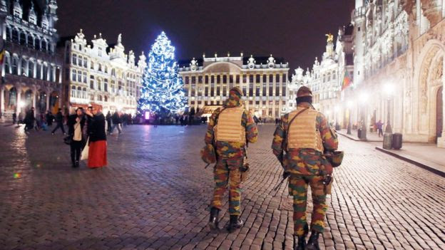 Two Belgian police officers patrol the Grand Place in Brussels, Belgium
