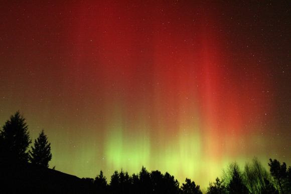 A wall of colorful red and green aurora met the eye and camera of Jim Schaff of Duluth this morning around 3 a.m. CDT. Credit: Jim Schaff