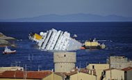 The stricken cruise liner Costa Concordia off the Isola del Giglio in January. The Costa Concordia, which crashed off an Italian island leaving 32 people dead, is to be refloated and towed away by a US-owned salvage company, the ship's owners said Saturday. (AFP Photo/Filippo Monteforte)