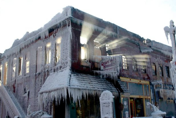 Sunlight streams through the windows of a building which caught on fire in Plattsmouth, Neb., Friday, Jan. 3, 2014, and the water sprayed on it by fire fighters froze. Much of the American northeast and the midwest are suffering from sub-freezing temperatures.