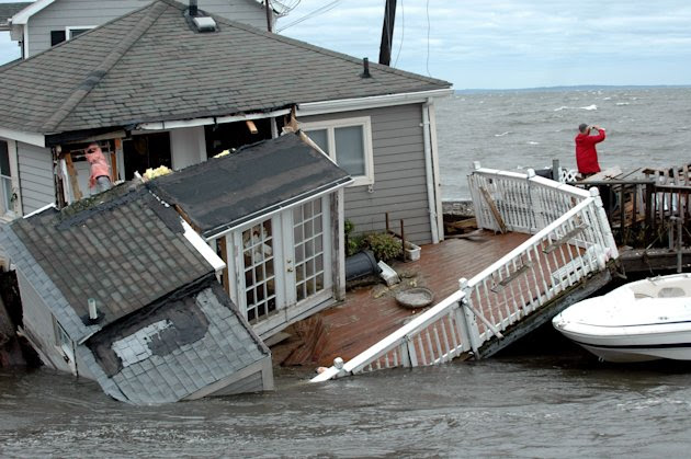 A Fairfield Beach Road home is submerged in Pine Creek in Fairfield, Conn. as treacherous weather caused by Tropical Storm Irene came through the area on Sunday Aug. 28, 2011. Tropical Storm Irene sen