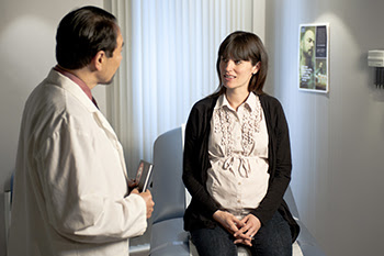 Pregnant woman talking to a physician