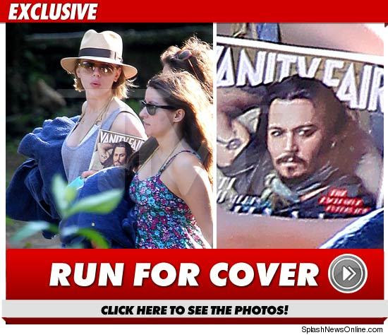 scarlett johansson in jamaica with vanity fair cover of johnny depp