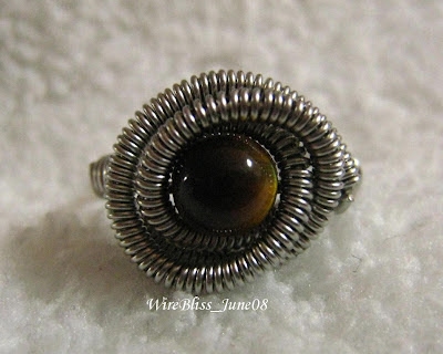 Coiled wire ring with Tiger's Eyes (6mm) focal.