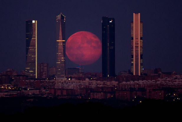 The moon shines through the Four Towers Madrid skyscrapers on August 11, 2014 in Madrid, Spain. . In yesterday's second supermoon of the summer, the moon appeared 30 percent brighter and 14 percent bigger than normal.