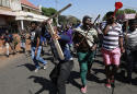 South African attacks on foreign shops continue; 12 dead