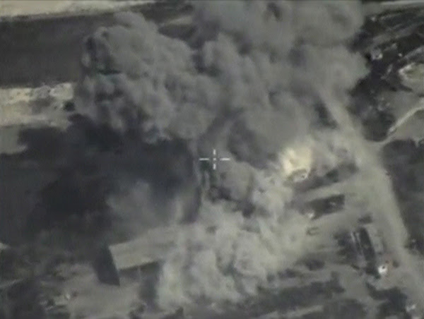 Frame grab taken from footage shows smoke rising after airstrikes carried out by Russian air force near Jisr al-Shughour
