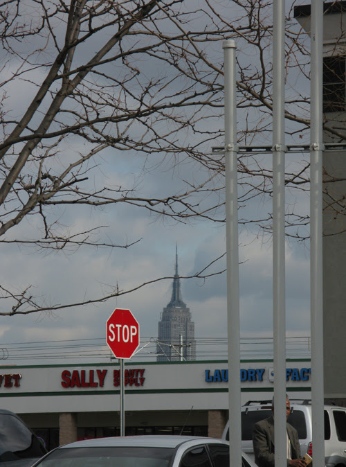 a peek at the Empire State Building and a lurking man