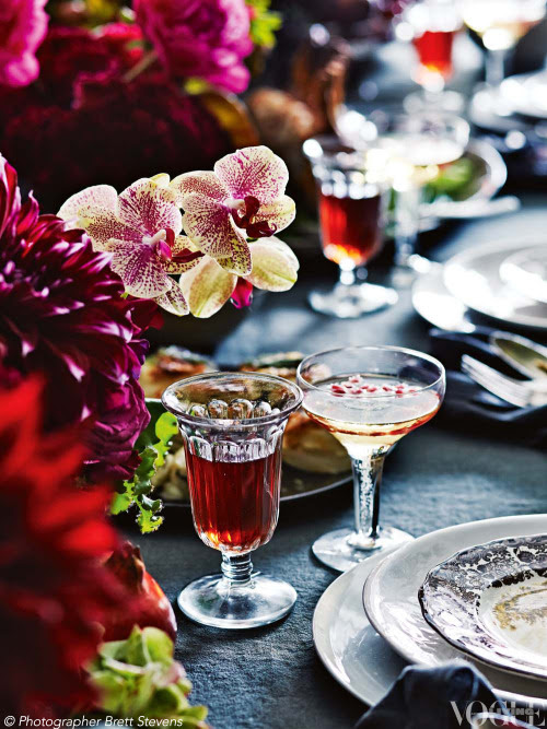 Sean Cook of Sydney florist Mr Cook shares his tips for a superb Sunday dinner. Known for his spectacular floral centrepieces, Cook has dressed his table with Phalaenopsis orchids and deep magenta dahlias. From 'At My Table' a story on page 47 of Vogue Living April 2013.  Photograph by Brett Stevens.