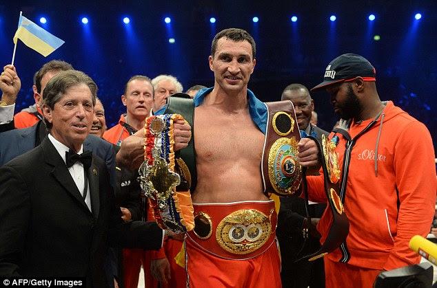Conveyor belt of success: Wladimir Klitschko celebrates victory over Australia's Alex Leapai after the WBA, IBF, WBO and IBO title bout