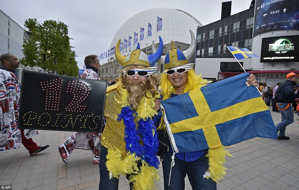 Optimistic! Fans from Sweden wore horned helmets and bore the cheeky sign '12 points' as they grinned at the camera