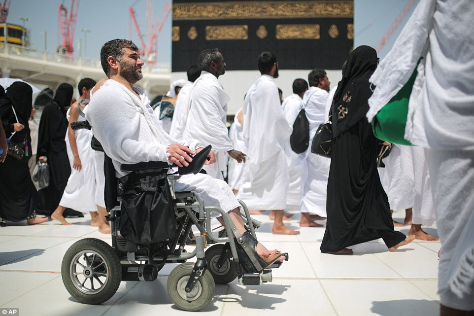 A Muslim pilgrim uses an electric wheelchair to circle the Kaaba. The Hajj requires physical perseverance, finances and a coveted Hajj visa, which is limited to country-by-country quotas to manage crowd safety