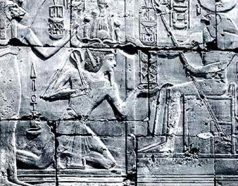 Seti I kneeling before Re in his Naos, followed by Sekhmet holding the Palm of the Years