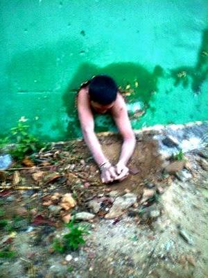 Detento ficou entalado em buraco com parte do corpo do lado de fora do presídio (Foto:  (Foto: Diassis Lira/Blog Diassis Lira))