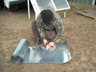 Cutting the Flashing for the Concrete Pier Homemade Termite Shield