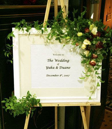 Photo of Wedding Ceremony Welcome Board with Flower