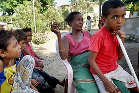 An East Timorese mother poses with her children in Dili