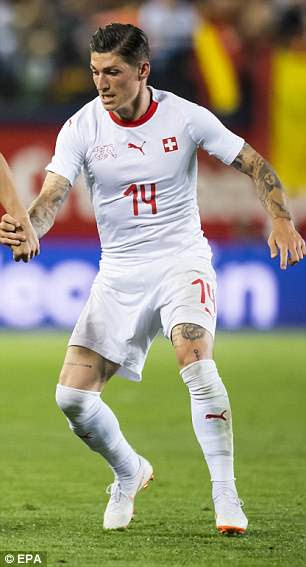 Switzerland's home and away kits feature the same template with reverses in colour