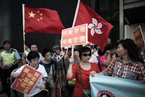 Demonstrators rally against the Occupy Central movement…