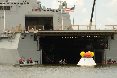 The Orion capsule is brought aboard USS Arlington. by Official U.S. Navy Imagery