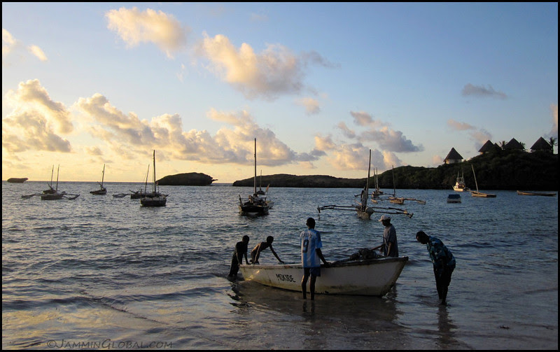 Jay catches men readying a fishing boat on the shores of Watamu in Kenya