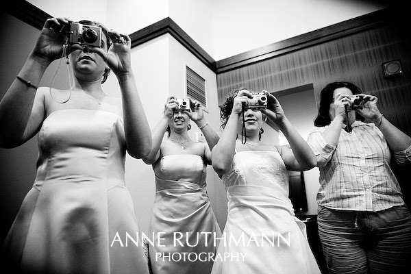 wedding guests with cameras up to faces