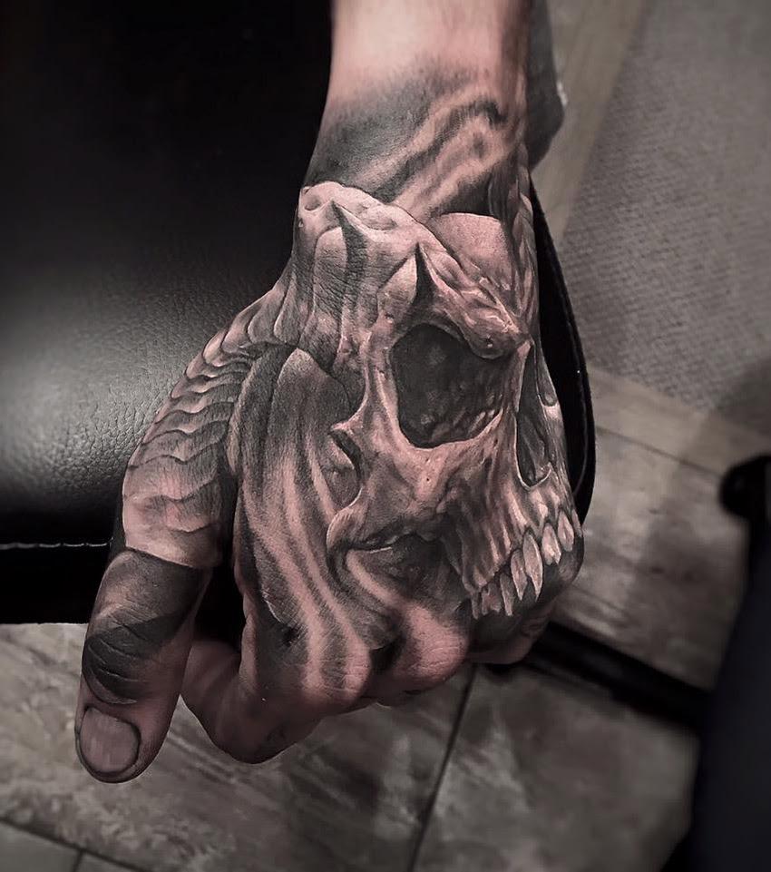 Horned Skull On Guys Hand Best Tattoo Design Ideas