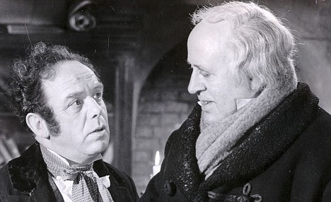 Alastair Sim, with Melvyn Johns, in a scene from Charles Dicken's 'Scrooge: A Christmas Carol' film in 1951