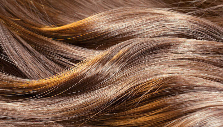 Dilute hydrogen peroxide in water to get lighter locks.