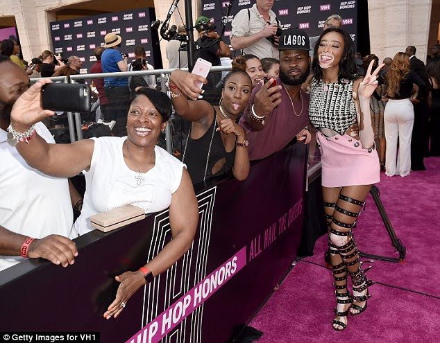 Strike a pose! The young model was down to earth as she took some time to take selfies with fans while on the red carpet