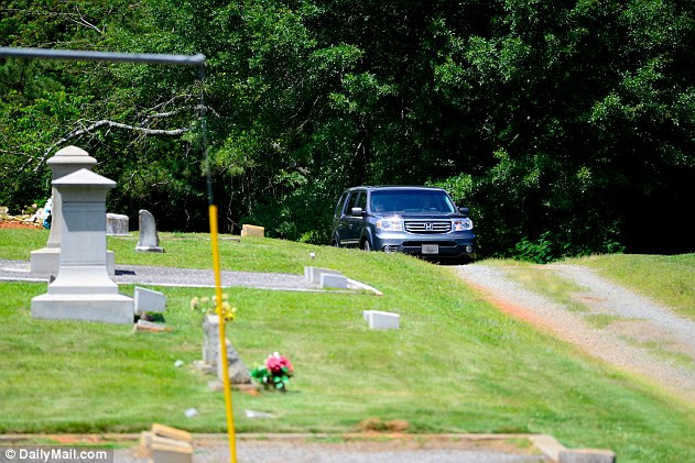 Procession: One of the funeral cars carrying guests to the memorial arrived at New Smyrna Cemetery