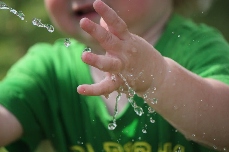 Baby Playing with Water Sprinkler and Hose (High Speed Pictures)