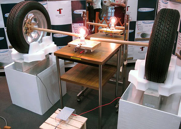 Japanese group transmits electricity through 4inch concrete block, demonstrates potential for powering cars on roads