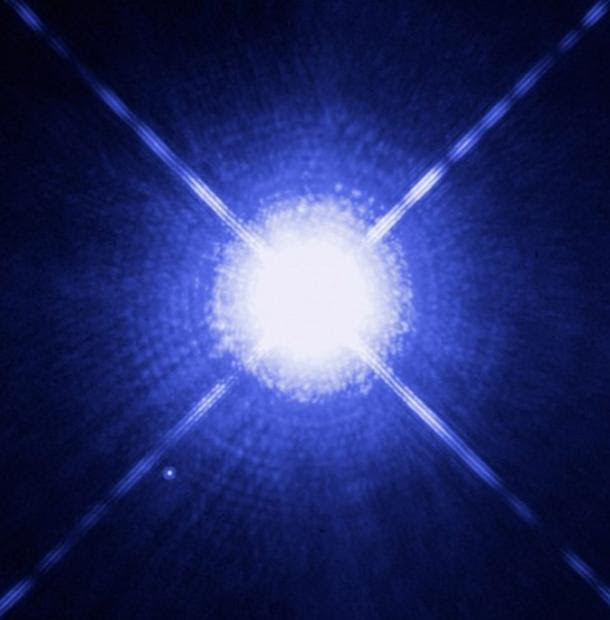 Sirius A and Sirius B as seen by the Hubble Space Telescope. The white dwarf can be seen to the lower left.