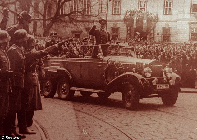 A car for a fuhrer: Adolf Hitler waves to crowds in his six-seater Mercedes car in this undated World War II photograph. Mercedes are one of a host of German companies that helped the Nazis