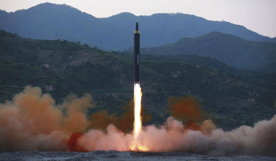 """FILE - This May 14, 2017, file photo distributed by the North Korean government shows the """"Hwasong-12,"""" a new type of ballistic missile at an undisclosed location in North Korea. North Korea on Monday, May 15, 2017 boasted it successfully launched a new type of """"medium long-range"""" ballistic rocket that can carry a heavy nuclear warhead, an escalation of its nuclear program. Independent journalists were not given access to cover the event depicted in this photo. (Korean Central News Agency/Korea News Service via AP, File)"""