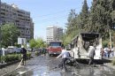 Firefighters work at the site of an explosion at al-Mezze neighbourhood in Damascus