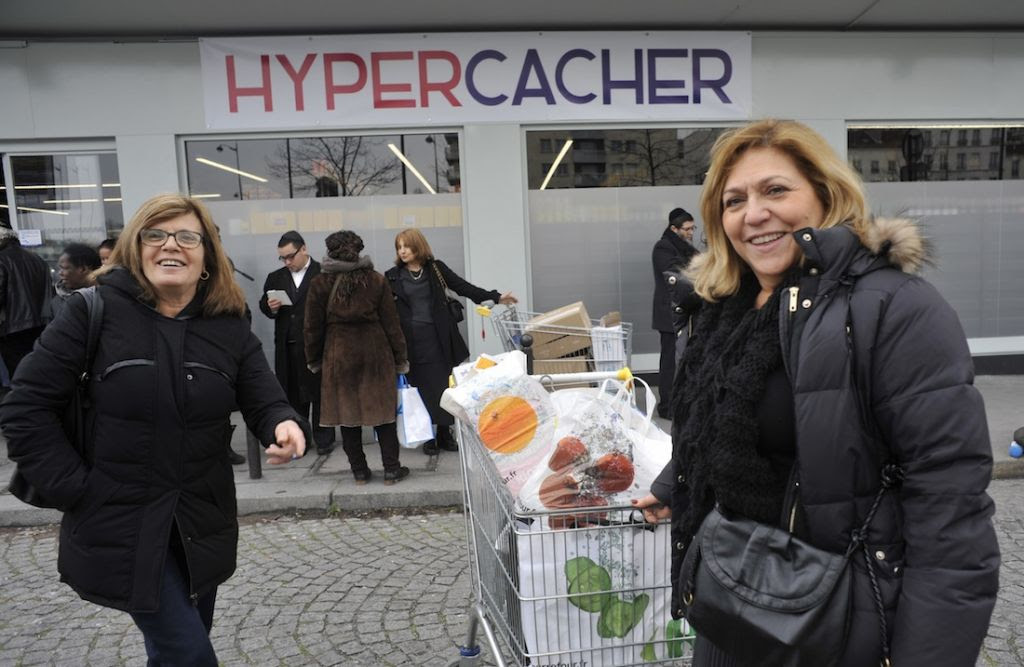 Shoppers outside the Hyper Cacher market near Paris, where four people were murdered in January. The shop reopened on March 15, 2015. (Serge Attal/Flash90/JTA)