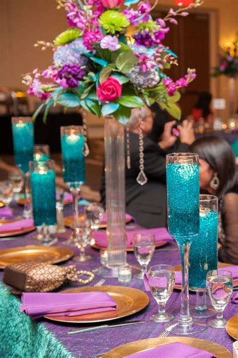 Gorgeous purple and teal wedding reception decor; Desi