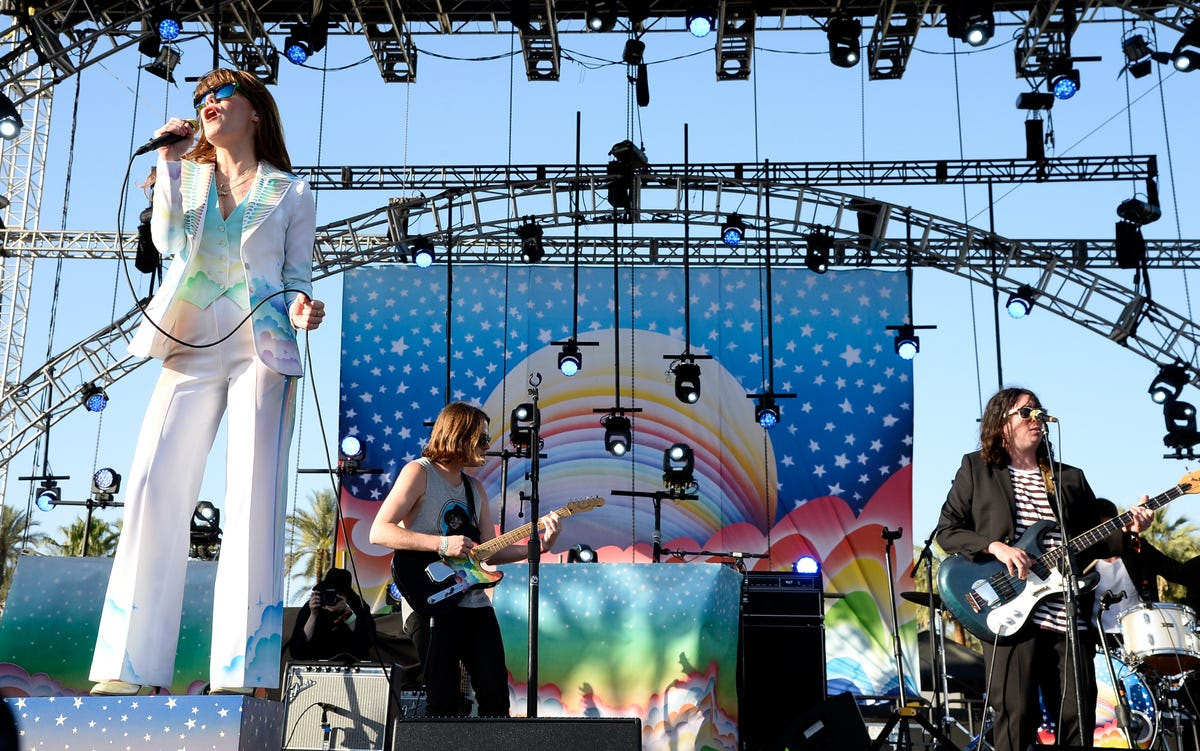Singer-songwriter Jenny Lewis' rainbow suit matched her set.