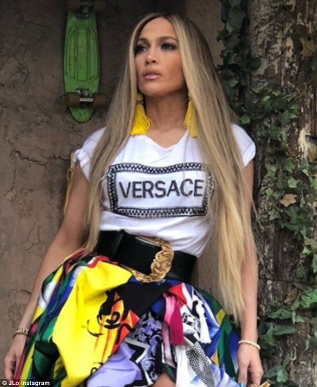 So Eighties:In a change for the fashionista, Jennifer wore a white-and-black Versace T-shirt